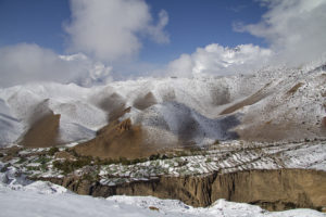 Looking down on snow covered village of Gurung